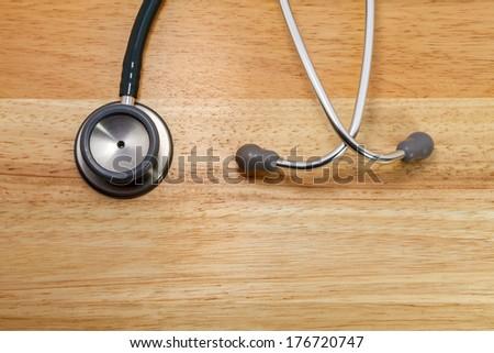 stethoscope on wood - stock photo