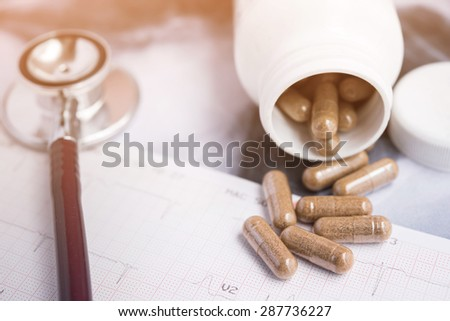 Stethoscope on X-ray image with medicine capsules, medical Concept  - stock photo