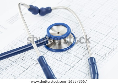 Stethoscope over ecg graph - studio shot - stock photo