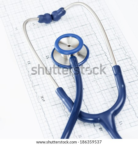 Stethoscope over ecg graph - 1 to 1 ratio - stock photo