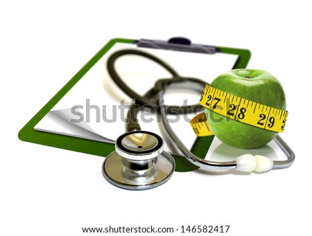 Stethoscope with apple and measurement tape  - stock photo