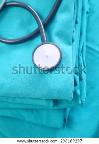 Stethoscope with blue doctor coat - stock photo