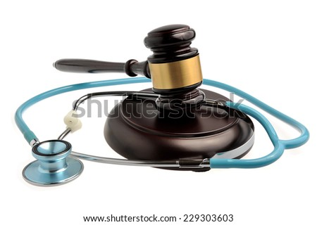 Stethoscope with judge gavel isolated on white background - stock photo