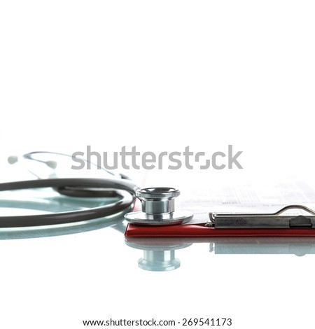 Stethoscope with medical clipboard - stock photo
