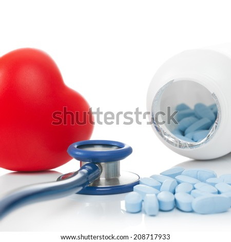 Stethoscope with red heart and pills - studio shoot on white - 1 to 1 ratio - stock photo