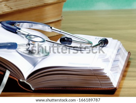Stethoscope with reference books - stock photo
