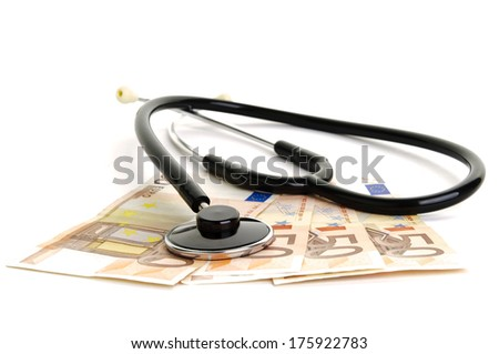 Stethoskope and money - stock photo