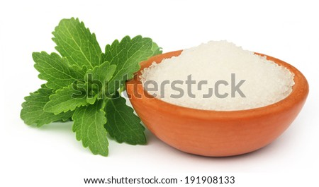 Stevia with sugar on a brown bowl - stock photo