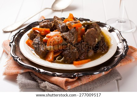Stew with beef and carrots in a plate, horizontal - stock photo