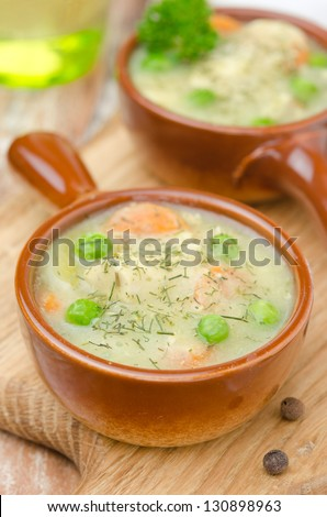 stew with chicken in a cream sauce portions in a pot closeup - stock photo