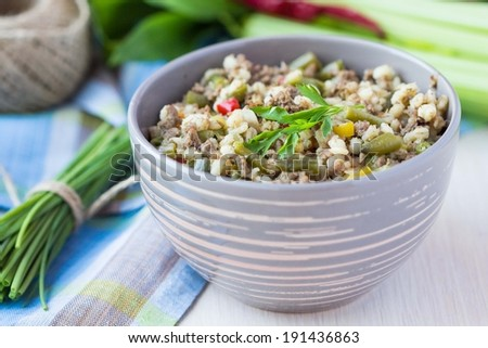 Stew with pearl barley, vegetables, minced meat, herbs, homemade delicious dinner - stock photo