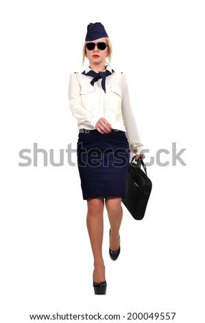 stewardess walking on a white background - stock photo