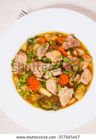 stewed meat with vegetables - stock photo