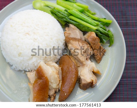 stewed pork leg with rice and kale - stock photo
