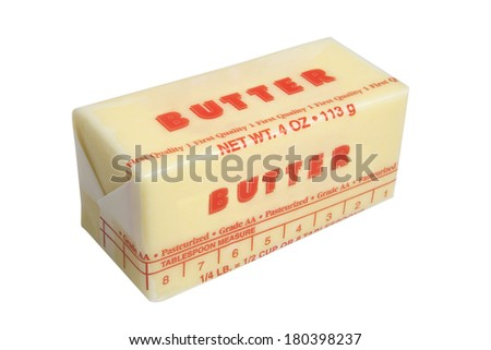 Stick of wrapped butter on white background  - stock photo