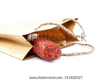 Stick sausage in a paper bag isolated on a white background. - stock photo