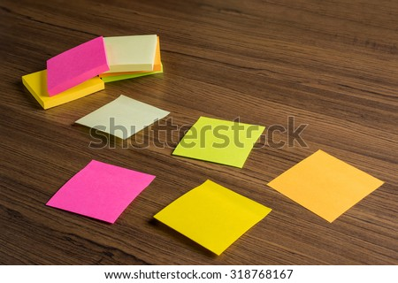 Sticks note paper on wood background for remind your memory still life style - stock photo