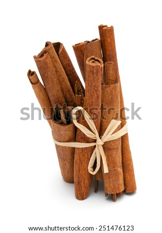 sticks of cinnamon isolated on white background - stock photo