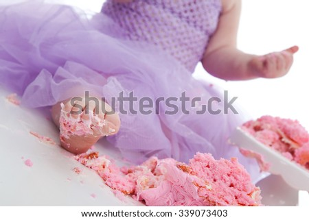 Sticky Foot!  Foot covered in frosting from a birthday cake. - stock photo