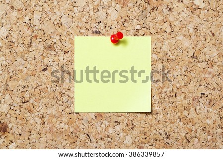 Sticky note on cork board - stock photo
