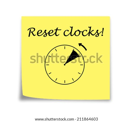 Sticky note reminder to set clocks back, black on yellow - stock photo