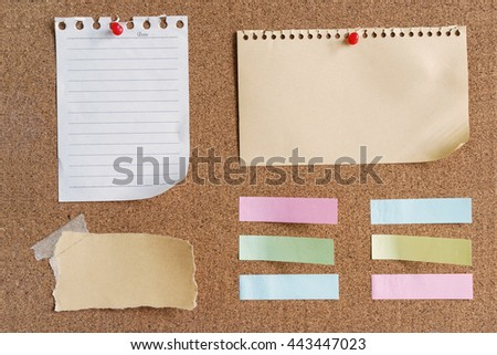 sticky notes and memo on cork board - stock photo