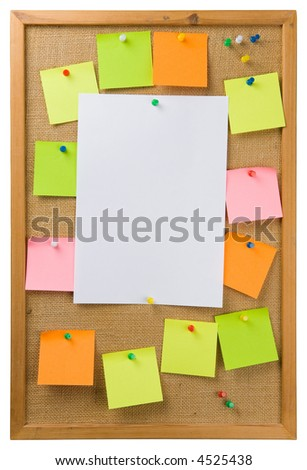 Sticky notes and sheet of paper attached to a noticeboard - stock photo