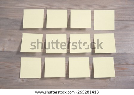 Sticky notes on wooden background, in vintage tone. - stock photo