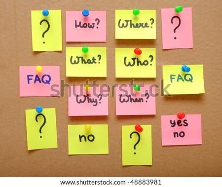 sticky notes over cardboard background - stock photo
