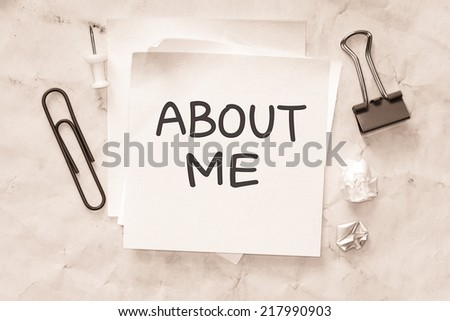 Sticky on crumpled paper with the phrase about me . room for text. - stock photo