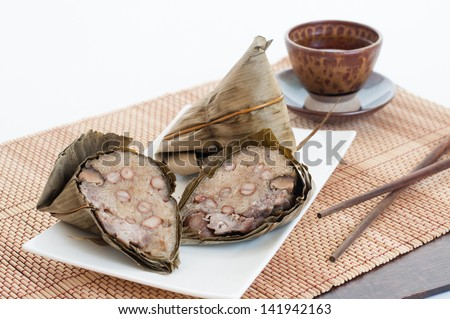 "Sticky rice dumplings or  ""Zongzi"" is a traditional Chinese food eaten during the dragon boat festival. - stock photo"