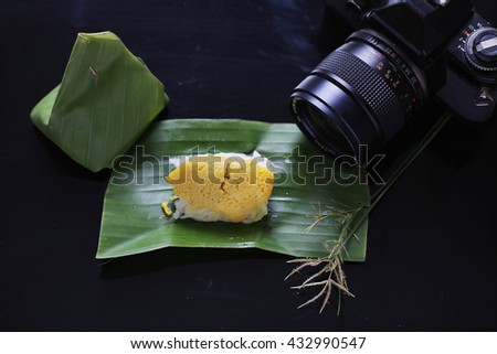 Sticky rice with steamed custard, wrapped in banana leaves,Thai dessert - stock photo