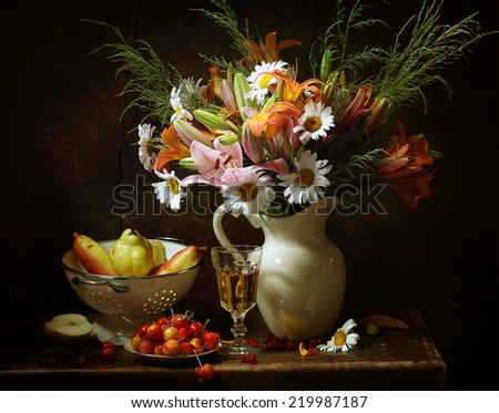 Still-life, appetizing juicy ripe pears both sweet sweet cherry and beautiful bright bouquet from pink and orange lilies and gentle camomiles in a white jug - stock photo