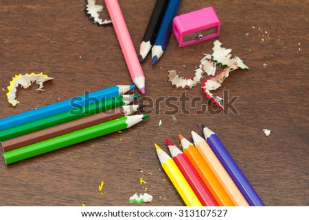 Still life, business, education concept. Crayons on a wooden table. Selective focus, top view, copy space background - stock photo