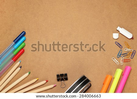Still life, business, education concept. Office supplies, clips, USB flash drive, stapler,  pens, markers and pencils on a table. Selective focus, copy space background, top view - stock photo