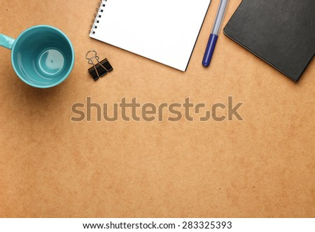 Still life, business, education concept. Office supplies, notepad, mug, clip and a pen on a table. Selective focus, copy space background, top view - stock photo