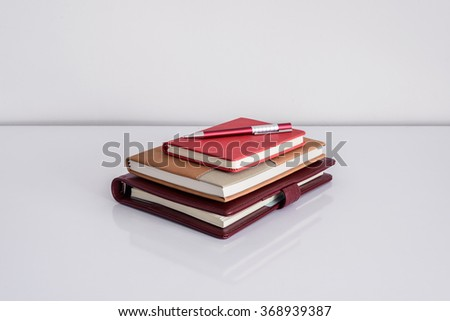 Still life, business, education concept. Pen with notebook on a table. copy space background - stock photo