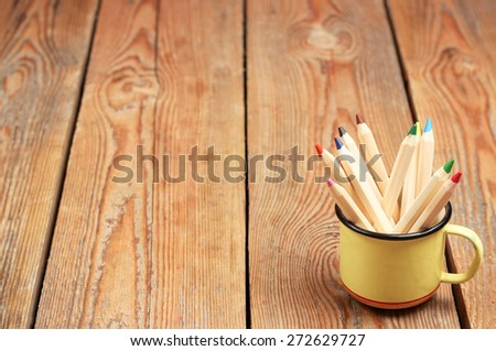 Still life, business, education concept. Pencils in a mug on a wooden table. Selective focus, copy space background - stock photo
