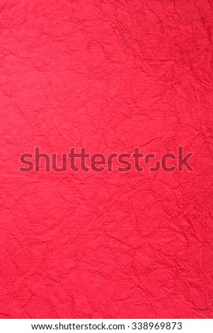 Still life close up detail of a bright vivid intense red rough grungy and wrinkled piece of paper with lines and texture. Plain full frame Christmas background with detail. Monotone color blank page. - stock photo