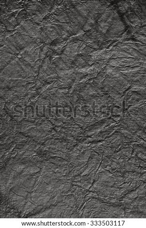 Still life close up detail of black and white rough grungy and scratched piece of paper with lines texture. Gray full frame background with wrinkles and texture detail. Monotone colorless blank page. - stock photo