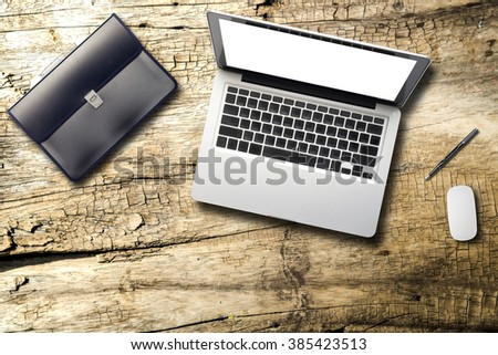 Still life details of laptop empty white screen material office desktop on wooden desk top view. - stock photo