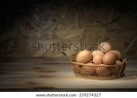 Still life eggs in the basket. This  eggs so fresh from farm. On the egg shell have dung and mucilage for safe freshness for long time. - stock photo