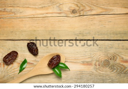 Still life, food and drink, holidays concept. Ramadan dates on a wooden table. Selective focus, copy space background, top view - stock photo