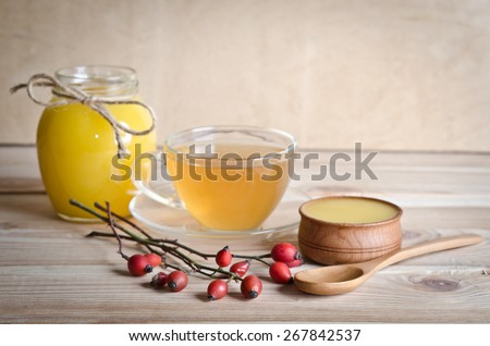 Still life from cup of tea , honey and hawthorn - stock photo