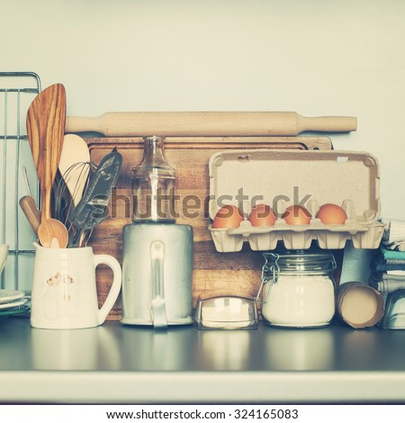 Still Life from Table Ware, Grocery, Different Stuff on Kitchen Table. Toned image - stock photo