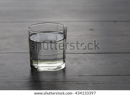 still life, glass of water on wood background - stock photo