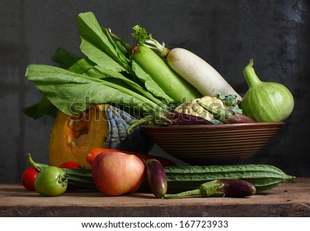 Still life harvested vegetables agricultural  on wooden background - stock photo