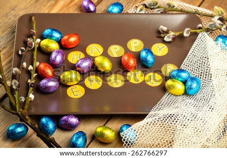 Still life, holidays, food and drink concept. Easter decoration with chocolate eggs and willow branch. Selective focus - stock photo