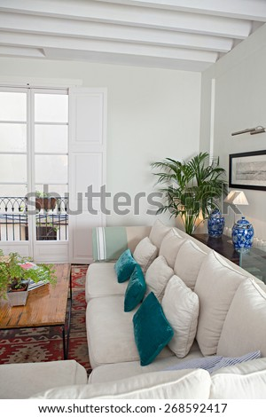 Still life home interior of an elegant family living room with a stylish white sofa. Elegant house living indoors. Aspirational luxurious lifestyle and living interior space. Desirable property. - stock photo