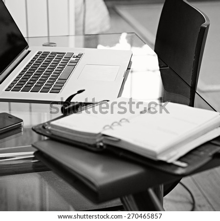 Still life home interior of an elegant office space room with technology and a glass desk. Elegant office and workplace living, indoors. Aspirational technology lifestyle and working interior space.  - stock photo